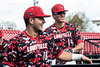 UofL catcher Pat Rumoro and outfielder Trey Leonard share a few lighter moments while warming up for a game against Virginia. 4/22/18