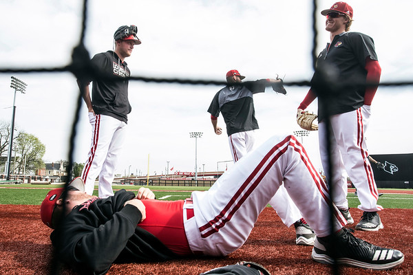 UofL baseball players stretch and warm-up for a game against Virginia. 4/22/18
