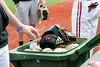 A bin of baseballs is rolled out onto the field as the UofL team prepares to take on Virginia in a Sunday afternoon game. 4/22/18