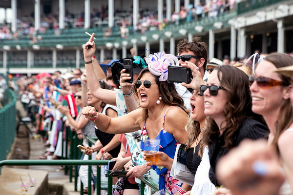 Fans cheer on their picks during the first race of Thurby at Churchill Downs on Thursday afternoon. 5/3/18