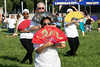 Tai Chi participants use fans as part of their workout during the Hike, Bike & Paddle at Waterfont Park on Monday. 5/28/18
