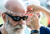 Heads were measured for cyclists looking for a helmet before the 12.5 mile ride during the Hike, Bike & Paddle. 5/28/18