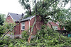 The rear view of a house in the Bon Air neighborhood reveals the extent of the damage caused when a Thursday thunderstorm collapsed a tree on the property. 6/1/18