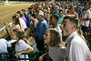 Shea Thompson and Alex Cook watch with excitement during the end of the 9th race at Churchill Downs on Saturday night. 6/2/18