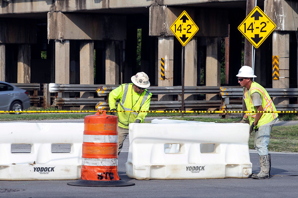 Barricades were brought in and installed around the perimeter of a sinkhole that appeared Thursday afternoon at Baxter Avenue and Liberty Street. 8/3/18