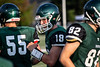 Trinity quarterback Seth Jutz celebrates with teammates after another touchdown against Ryle High during a scrimmage on Friday night. 8/10/18