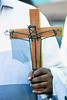 The Rev. Clay Calloway held a cross during a 32nd Street prayer service organized by the Interdenominational Ministerial Coalition on Tuesday night. 8/28/18