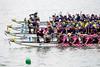 Teams furiously paddle at the start of a Saturday morning race on the Ohio River during Louisville Dragon Boat Festival. 9/8/18