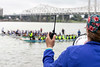 Kimberly Kent instructs teams to line up for the start of a race on the Ohio River during the Louisville Dragon Boat Festival on Saturday. 9/8/18