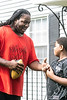 Demetric Flint receives a little football coaching from his uncle Sayheed Ashanti on Sunday morning. 9/16/18