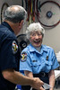 LMPD crossing guard Naomi Thomas laughed along with Chief Conrad while being honored for her 50 years on the job. 9/19/18
