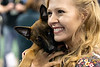 Rainy Greene shares a tender moment with one of the dogs available for adoption during the Mutt Madness event at Freedom Hall on Thursday. 10/18/18
