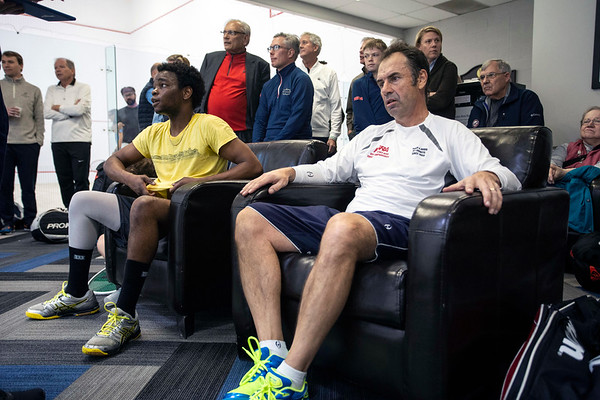 """Squash opponents Kudzaishe """"Kay Zee"""" Sitshebo and Richard Millman relax and watch the match after theirs at the Louisville Boat Club on a Saturday afternoon. 11/10/18"""