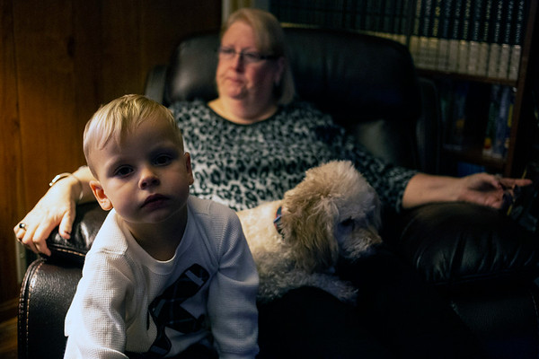David Williams Saleh sits on the lap of Faye Saleh along with one of the family dogs Susie. 11/12/18