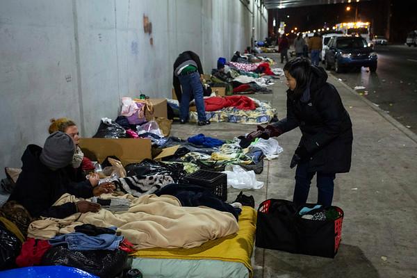 Beargrass Christian Church volunteers tend to the homeless on a freezing night along Jefferson Street. 11/26/18