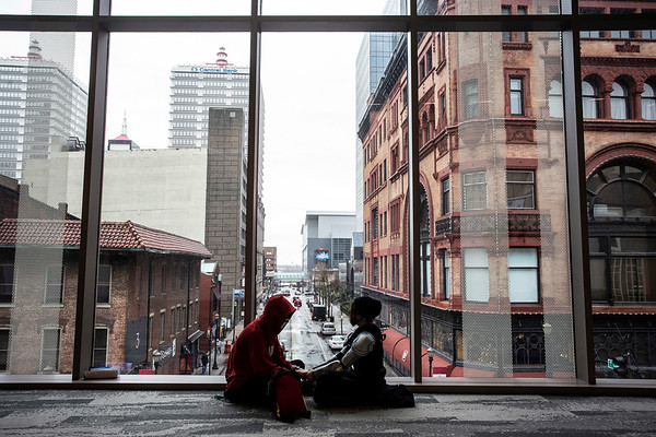 A pair of cosplayers take a break during Louisville SuperCon to enjoy one of the many new views at the Kentucky International Convention Center. 12/1/18