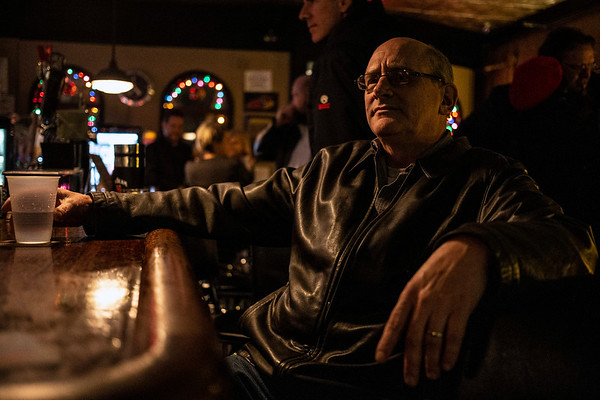 Barret Bar owner Rick Wessling sits in the middle of the action at the end of the bar on a Wednesday night. 12/5/18