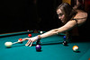 Jennifer Little sizes up the shot on one of the many pool tables at the Barret Bar. 12/5/18