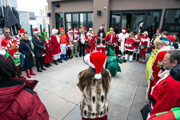 "Participants in Saturday's SantaCon began the day at 8UP with a rooftop breathing exercise that ended with the festive phrase ""ho-ho-ho"" before embarking on a journey of good will. 12/8/18"