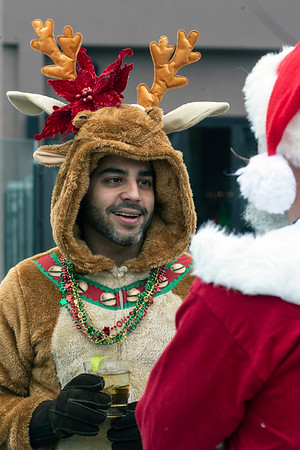 Alain Benitez donned the reindeer costume for SantaCon on Saturday. 12/8/18