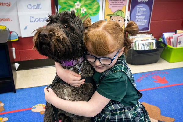 St. Patrick student Hadley Jo Lange has a friend and protector in her service dog Ariel. 12/11/18