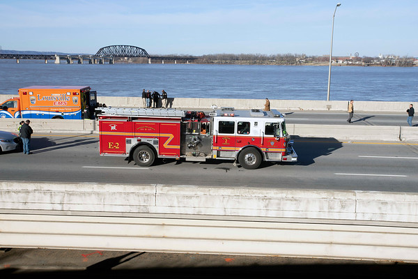Emergency vehicles line I-64 East near the Belvedere after a fatal accident involving LMPD was reported at the site on Monday afternoon. 12/24/18