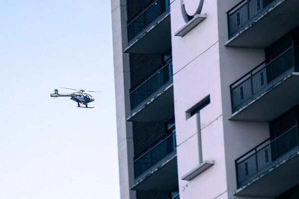 An LMPD helicopter surveys the scene of a fatal accident on I-64 that occured near The Galt House Hotel Monday afternoon. 12/24/18