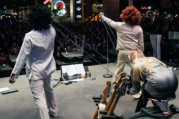 The band 100% Poly used a giant slingshot to hurl mementos to the new years eve crowd at Fourth Street Live on Monday night. 12/31/18