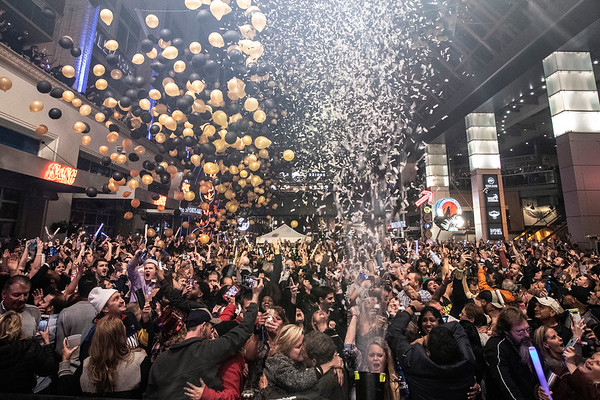 Balloons dropped as confetti cannons erupted over the thousands celebrating the arrival of 2019 at Fourth Street Live on Monday night. 1/1/19