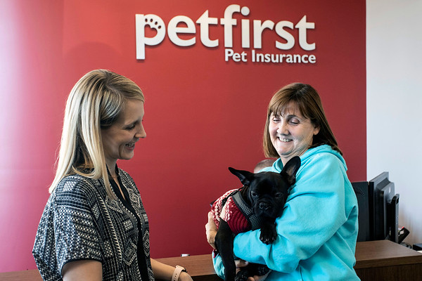 Lisa Recker and her French bulldog Winston are greeted by Katie Blakely in the lobby of PetFirst in Clarksville. 1/10/19