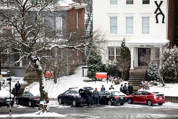 UofL students clear off cars after a late night snowfall blanketed Louisville for the first time in 2019. 1/12/19