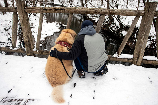 Drew Butler and his dog Sunny watch for passing ducks in Beargrass Creek on a snowy Saturday morning in Cherokee Park. 1/12/19