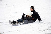 Josh and Elise Myers pick up speed while sledding down Baringer Hill in Cherokee Park on Saturday morning. 1/12/19