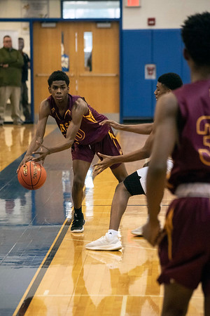 Doss guard Chris Anderson keeps the loose ball in bounds against Ballard during the first round of the Louisville Invitational Tournament at Valley High School on Monday afternoon. 1/14/19