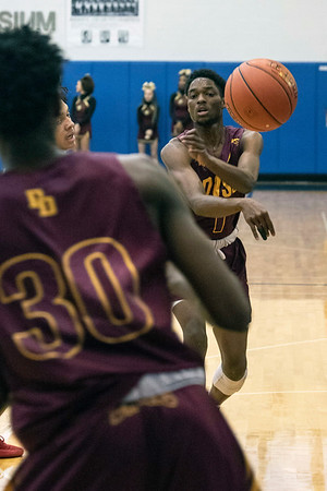 Doss guard Terrell Taylor gets the ball to teammate Tony Moss during the first round of the Louisville Invitational Tournament at Valley High School on Monday afternoon. 1/14/19