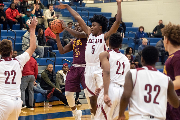Doss guard Chuck Boyd tries to get to the basket against Ballard defender Kaelon Harkema during the first round of the Louisville Invitational Tournament at Valley High School on Monday afternoon. 1/14/19