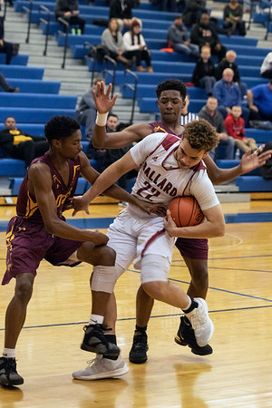 Ballard's Terrence McDaniels fights for a rebound against Doss during the first round of the Louisville Invitational Tournament at Valley High School on Monday afternoon. 1/14/19