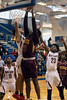 Doss forward Tyione Downstakes the shot against the Ballard defense during the first round of the Louisville Invitational Tournament at Valley High School on Monday afternoon. 1/14/19