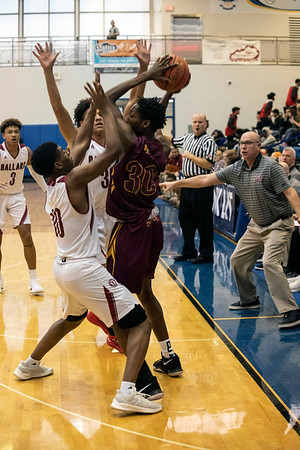 Several Ballard Bruins make it difficult on Doss forward Tony Moss during the first round of the Louisville Invitational Tournament at Valley High School on Monday afternoon. 1/14/19
