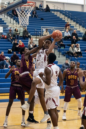 Ballard battled Doss during the first round of the Louisville Invitational Tournament at Valley High School on Monday afternoon. 1/14/19