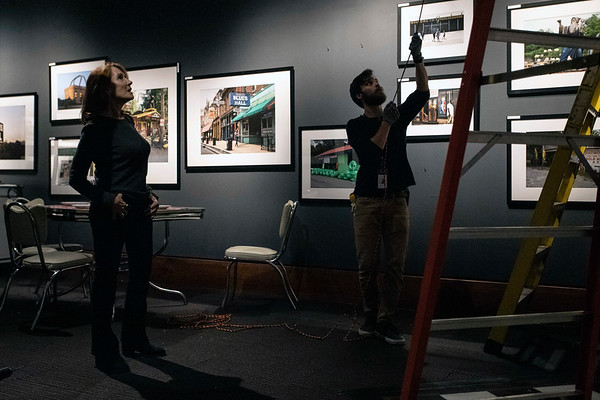 Linda Bruckheimer supervises the installation of one of many classic roadside signs featured in her latest collection Roadmap to Heaven. The Frazier History Museum exhibit will open on January 22nd. 1/15/19