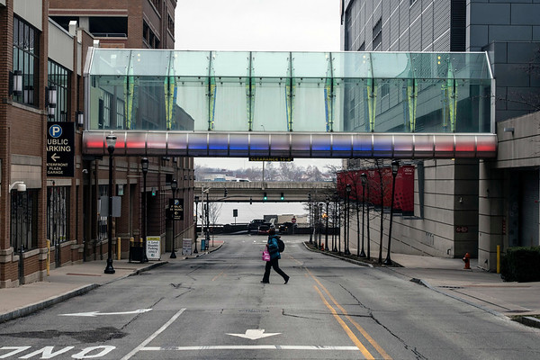 A colorfully lit span of the Louie Link provides access to the KFC Yum Center over 3rd Street. 1/16/19