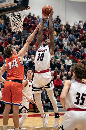 New Albany's Julien Hunter goes up strong against Silver Creek on Friday night. 1/18/19