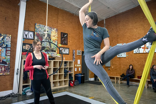 Suspend Louisville instructor Courtney Lantz demonstrates technique to Courier Journal reporter Maggie Menderski during a Saturday morning class for beginners. 2/2/19