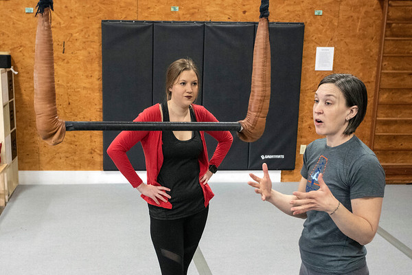 Suspend Louisville instructor Courtney Lantz introduces Courier Journal reporter Maggie Menderski to the trapeze bar during a Saturday morning class. 2/2/19