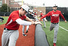 UofL baseball players Ben Metzinger and Alex Binelas stretch before practice at Patterson Stadium on Tuesday afternoon. 2/5/19
