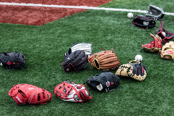 Scattered gloves spread out at Patterson Stadium were ready to be called into action during a UofL practice on Tuesday afternoon. 2/5/19