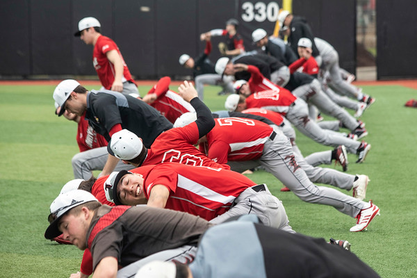 The UofL baseball team stretches before practice at Patterson Stadium on Tuesday afternoon. 2/5/19