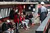 Members of the UofL baseball team take cover before practice on a rainy afternoon at Patterson Stadium. 2/5/19