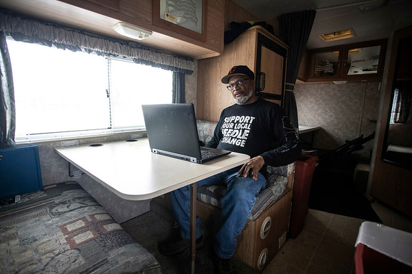 Volunteers of America project manager Donald Davis works from a laptop in an RV along Bicknell Avenue on a Wednesday afternoon. The RV serves as a needle exchange station there each week. 2/6/19
